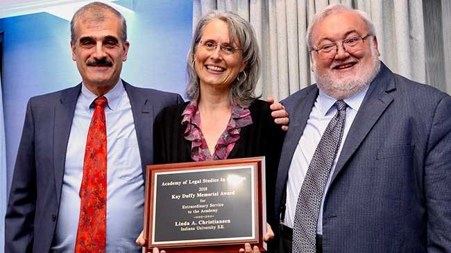 Linda Christiansen receives the Kay Duffy Memorial Award at the ALSB academic conference in Portland, Oregon, in August, 2018. Representing the ALSB are Jody Blanke (l), professor at Mercer University and past ALSB president, and Dan Herron (r), professor at Miami University and ALSB executive secretary