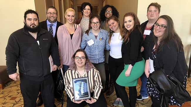 The 2017 Horizon staff poses with the Division II Newspaper of the Year award from the Indiana Collegiate press Association.