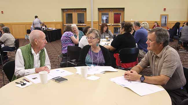 Communications instructor Gunter Wall, writing instructor Lynn Slaughter, and Mike Godbey, assistant professor of mathematics talk teaching tactics during a workshop at the ILTE Teaching Mini-Conference.