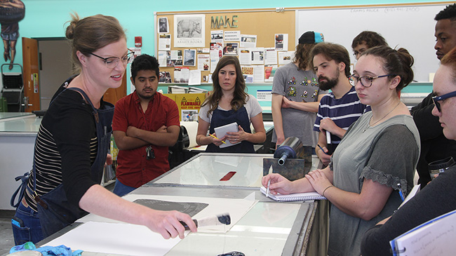 Susanna Crum (l), assistant professor of fine arts, introduces color printing to students in a basic printmaking class.