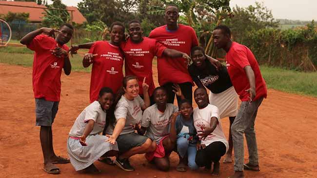IU Southeast business major Renata Kelley with residents of Jinja, Uganda.