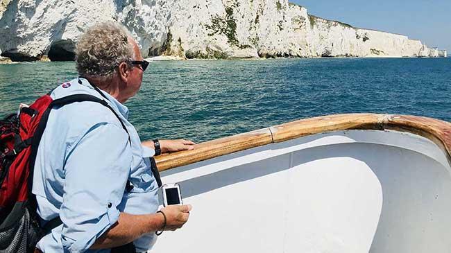 Dr. Glenn Mason in boat off the coast of England.