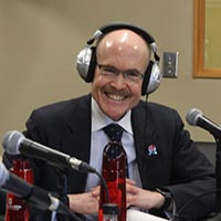 Ambassador James P. Zumwalt wearing radio headphones.