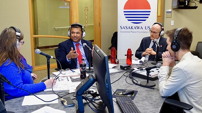 Dr. Satu Limaye makes a point during a discussion on the International Power Hour radio show, as Ambassador James P. Zumwalt listens.