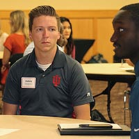 Student Zackery Henderson listens to employer.