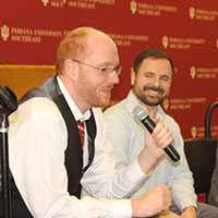 Jeremy Eiler and Caleb Miller participate in panel discussion.