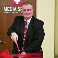 Chancellor Dr. Ray Wallace cuts ribbon at Media Space.