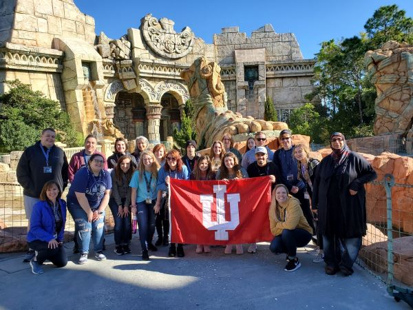 IU Southeast students and instructors John Ross and Sumreen Asim at a theme park in Orlando, Florida.